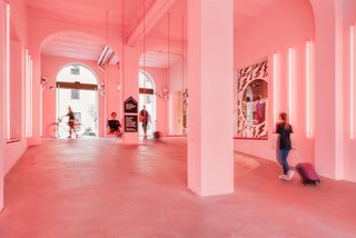 Pink neon lights give the palazzo's entry area an otherworldly feel.