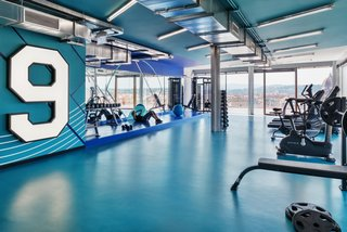 The hotel's blue-walled gym, complete with an impressive view of Florence, is designed to inspire.