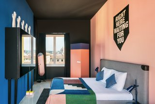 The guest rooms continue the design themes found in the rest of the hotel, with cheeky artwork, bold colors, and geometric textiles.