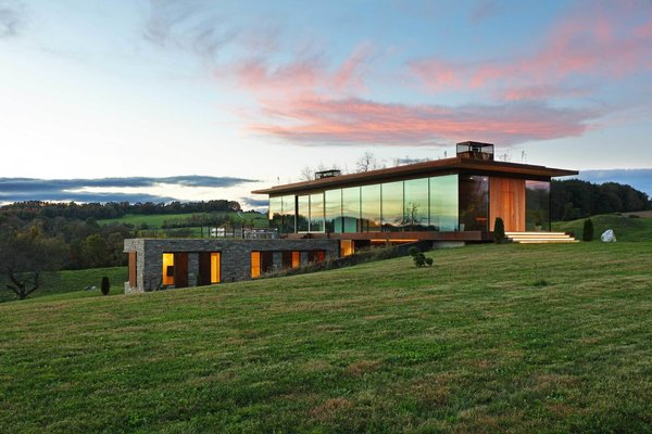 A Green Home Made of Glass, Stone, and Wood Sits Lightly Upon the Land
