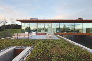 A green roof and terrace are accessible from the top-floor kitchen.