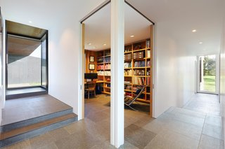 On the lower level, stone flooring and superinsulated walls help regulate temperature and reduce energy needs.