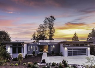 Nestled along the slopes of Kingston, Washington, with views of Puget Sound, this home has a second level that takes advantage of the sloped site. The home has 3,400 square feet of living space, including three bedrooms and a two-car garage.