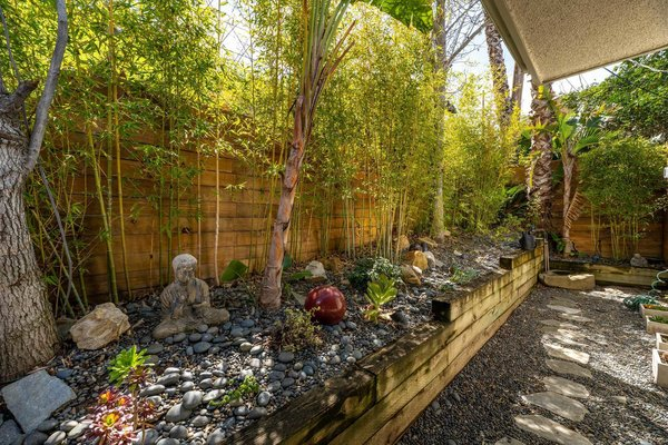 The zen garden, while small, provides a peaceful visual and physical respite from the rest of the home.