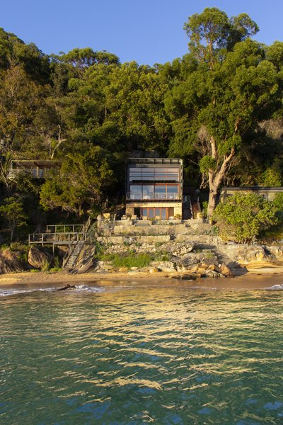 Casey Brown Architecture designed the Hart House, a modern update to the one-room Australian beach shack that overlooks Great Mackerel Beach. The contemporary home mimics the shack vernacular with its simple, boxy construction that's wrapped in a protective shell of corrugated metal.