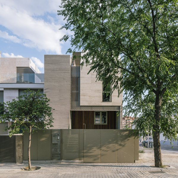 Transparent sections of the home's facade allow daylight to filter inside.