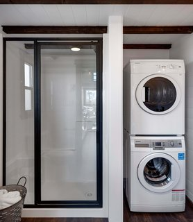 The home is also outfitted with a full bathroom with a composting toilet and a stacked washer-dryer unit.