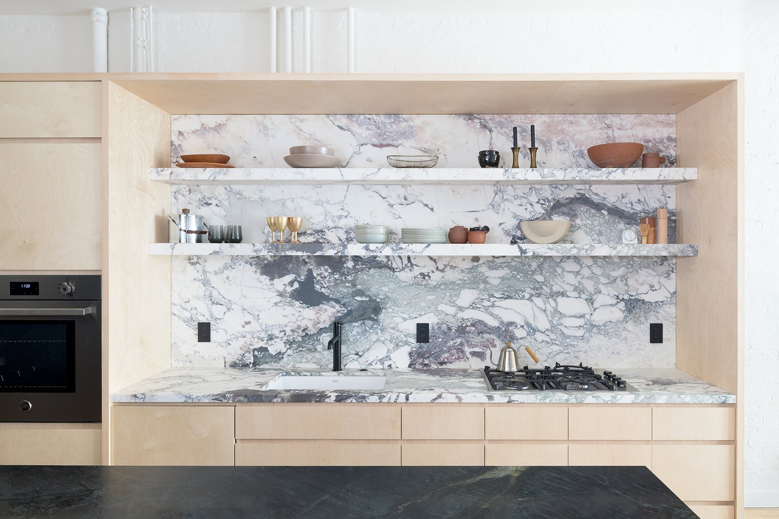 Brooklyn Loft plywood and marble kitchen wall
