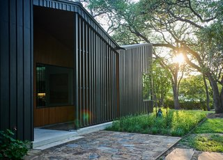 The rhythm of the battens is picked up at the vertical screen of the front porch to provide some privacy for the large picture window behind.