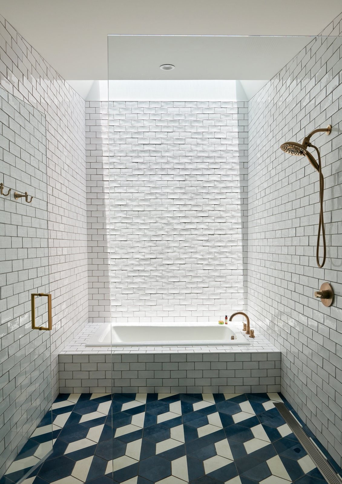 Ridgeview House white tile bathroom with skylight