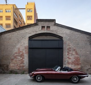The front door doubles as a garage door for the vintage car, which parks in the front entry at night.