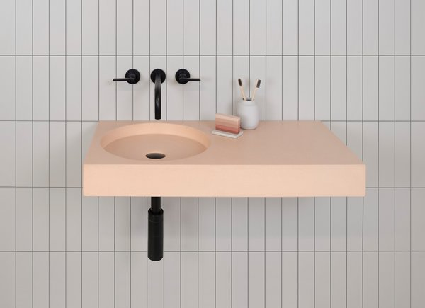Cero offers an offset vanity and a circular bowl.