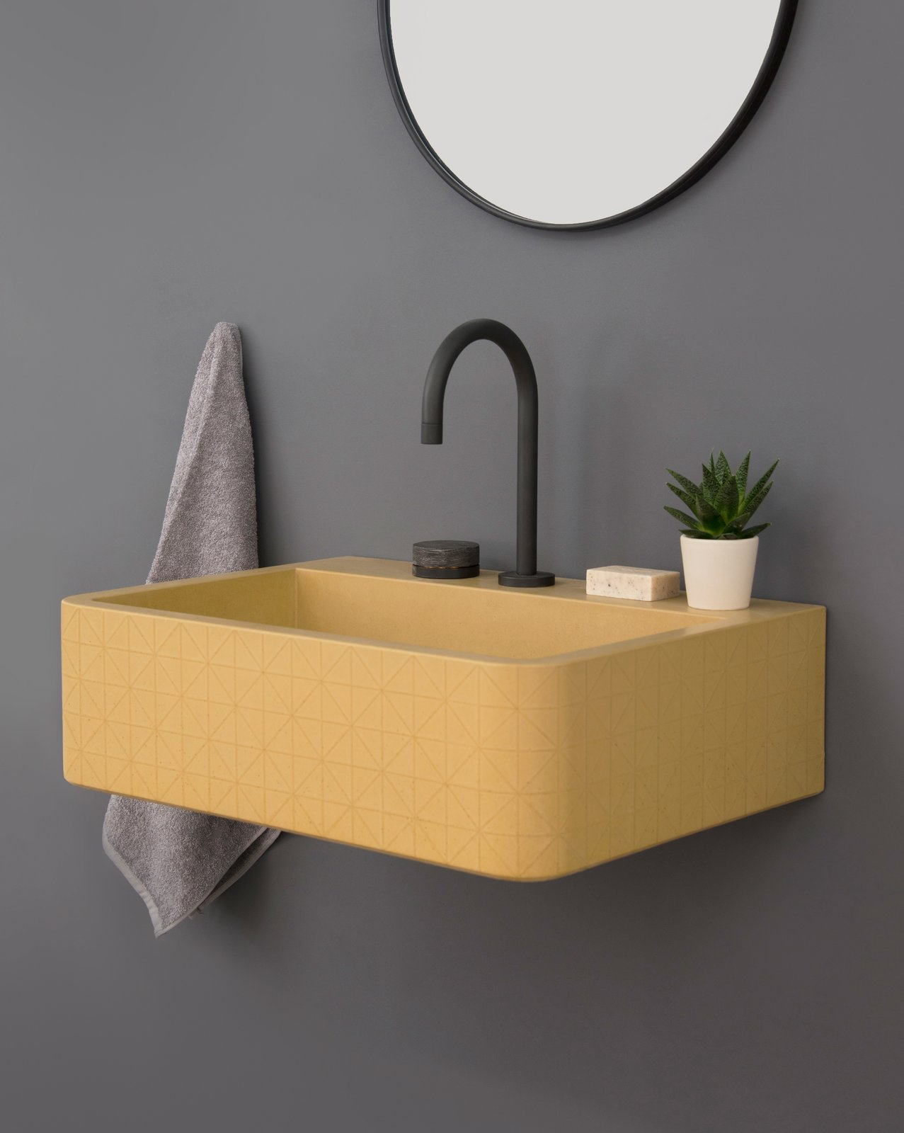 Bath Room and Wall Mount Sink The triangular pattern on the Vos sink adds texture and depth to its appearance.  Photo 3 of 10 in Trend Report: Bathroom Fixtures Go Bold in a Rainbow of Retro Hues