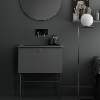 Swoon's Studio line of bathroom vanities are simple and minimalist, with slender legs and a single-pull drawer for the vanity.