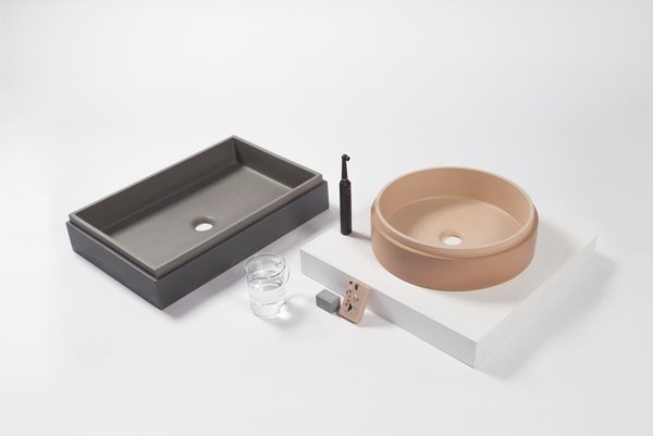 """Available in ten different shades, the sink basins from Nood Co's concrete sinks are come as a vanity set or in several different shapes, including """"pill""""-shaped, trough, circular bowl, and a rectilinear box."""