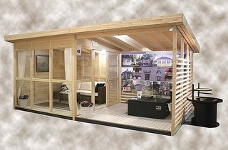 This studio or garden house kit features equal parts indoor and outdoor space.