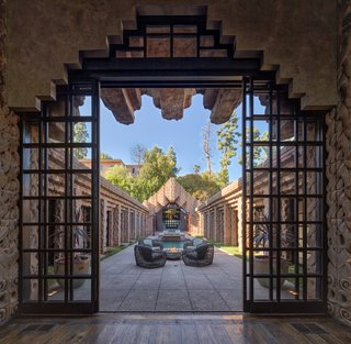"""""""While it looks imposing from afar,"""" say the owners, """"once inside, it's tranquil and spiritual, a complete separation from the noise and bustle of 21st-century L.A."""""""