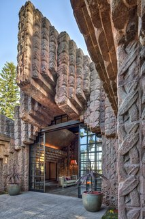 The concrete textile blocks are a signature of Lloyd Wright and his father, Frank Lloyd Wright.