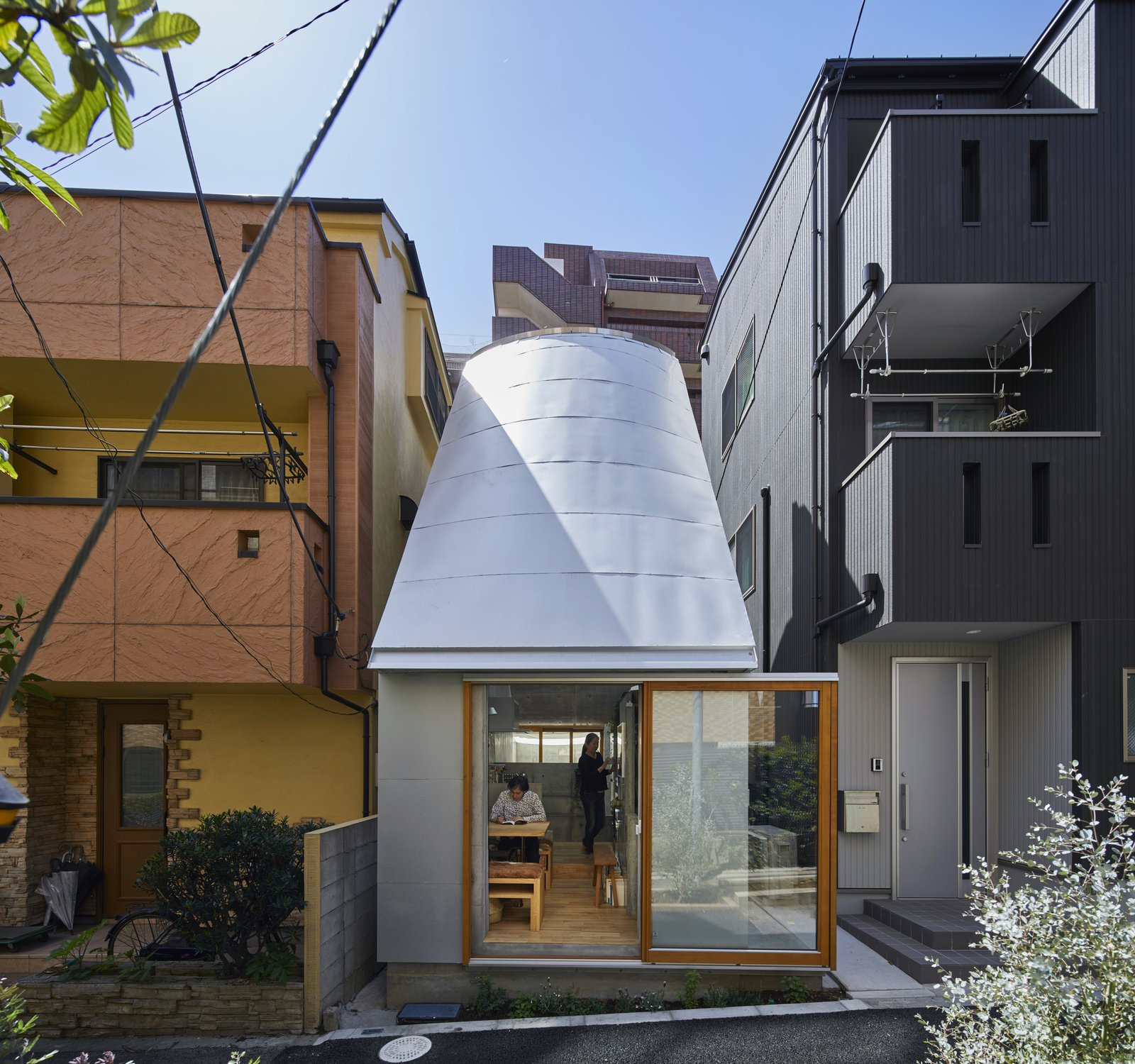 Exterior, Metal Roof Material, House Building Type, Curved RoofLine, Concrete Siding Material, and Tiny Home Building Type After living ten years in another house he designed in Yokahama, Hosaka and his wife decided to move to Tokyo for an easier commute.  Photo 1 of 12 in A Concrete Tiny House in Tokyo Opens to the Sky—and the Street
