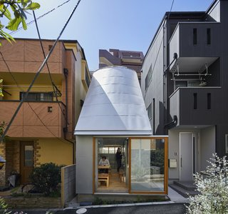 A Concrete Tiny House in Tokyo Opens to the Sky—and the Street