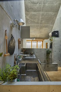 Concrete lends texture to the interior without overwhelming it—the high ceilings and wood floors balance the aesthetic.