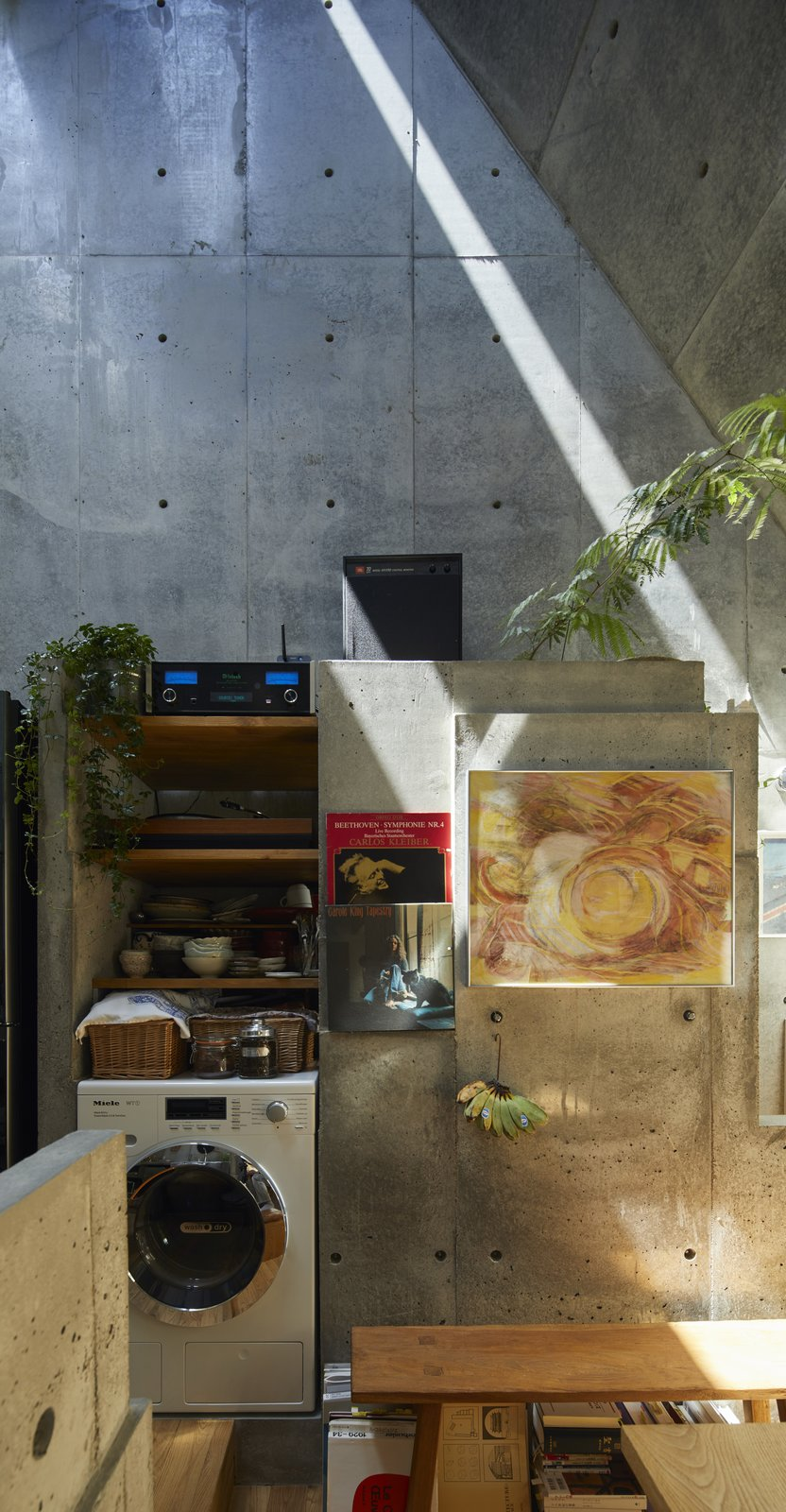 Storage Room and Shelves Storage Type The skylight provides changing daylight throughout the year, even when direct sunlight doesn't come through the front or back glass windows.  Photo 5 of 12 in A Concrete Tiny House in Tokyo Opens to the Sky—and the Street