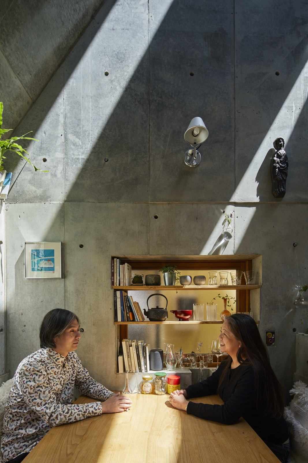Living Room, Bench, and Wall Lighting The couple made several decisions about the home together, from the appropriate size to the types of spaces they needed.  Photo 7 of 12 in A Concrete Tiny House in Tokyo Opens to the Sky—and the Street