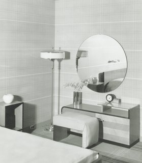 """One of the furniture lines for the 1933 Chicago World's Fair was designed by Gilbert Rohde, the company's first in-house modernist designer (previously, the company produced more traditional furniture lines). The series was based on his """"grouping principle"""" that made storage and dresser units all the same shape and height so that they could be concentrated uniformly on a single wall. At the time, traditional dressers provided different shapes and sizes for men and women, so this was a marked contrast and ended up catapulting the company onto the world stage. (No. 3319 Group bedroom chests displayed in the Design for Living House, 1933, Century of Progress exposition, Chicago World's Fair.)"""