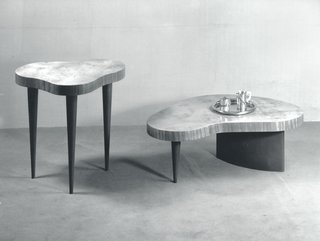 Throughout the 1930s and early 1940s, Gilbert Rohde continued to design elegant, of-the-moment pieces that seemed to anticipate consumer's needs. In both his own office in New York City and in the pieces he designed from 1939 to 1941, Rohde began to exhibit an interest in curvilinear, biomorphic form—possibly inspired by the work of Alvar and Aino Aalto in the late 1930s. These undulating pieces by Rohde were show in an installation for the Contemporary American Industrial Art exhibition at the Museum of Modern Art, and were seen as one of the first biomorphic furniture designs that were manufactured in the United States. (No. 4187 and No. 4186 Paldao Group tables designed by Gilbert Rohde, 1941.)