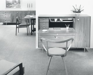 In 1958, the Rosewood Group was renamed Thin Edge not because of its revamped profiles and forms, but because of the expanded range of options and the inclusion of hardwood veneers on the furniture. Pieces like the Pretzel Chair provided an airy, sculptural counterpart to more rigid, regular lines of the group's chests and desks. The Pretzel Chair, made out of laminated and bent plywood and first produced in 1952, was very influential in the development of the more-popular Cherner armchair, also made out of bent laminated plywood. (No. 5733 Thin Edge chest desk with No. 5890 Pretzel chair designed by George Nelson, 1958.)