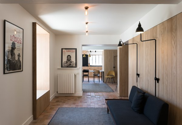 The home's palette begins with fresh white walls that reflect daylight. Cream undertones in the white avoid lend a sense of warmth to the space.