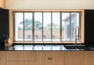 The wide windows in the kitchen allow for views while the residents are in front of the sink or cooking at the long countertop.