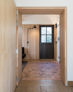 Every detail was considered—from the door hardware to subtle reveals around panels of solid oak.