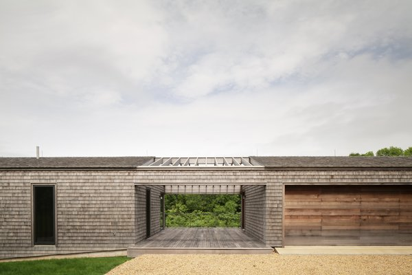 In addition to the 4,000-square-foot home, there is also a new guest house and garage with a shared porch that continues the material palette and design language established at the main house.