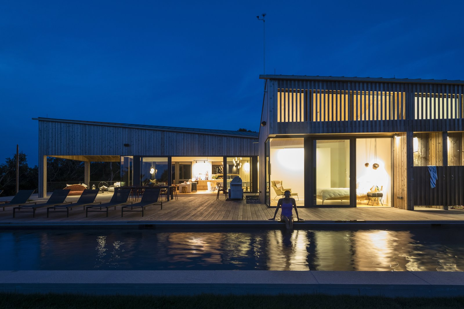 Martha's Vineyard House by Anmahian Winton Architects lap pool at night