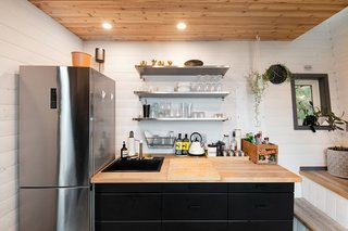 Windows were strategically located throughout the home, including this small aperture at the bottom of the stairs that lets natural light into the kitchenette.