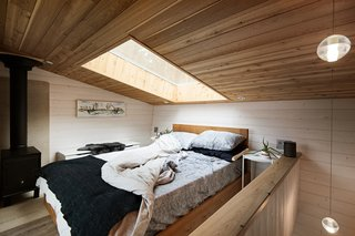 A well-placed skylight directly over the bed in the lofted bedroom is perfect for stargazing and bringing in natural daylight.