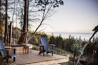 A hot tub with a view encourages guests to spend more time outside soaking in the view.