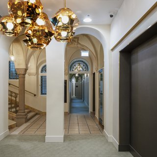 Lighting and light fixtures provided an opportunity to insert modern, contemporary elements into otherwise historic spaces, like the stairs and corridors of the hotel.