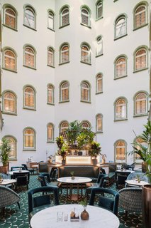 Paris Court is one of the only buildings in Budapest with a courtyard—and this space became an important part of the renovation. The architects enclosed it with a new glazed skylight, allowing it to function as a restaurant for the new hotel.