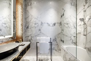 Materials like marble match the high quality of the original building—but they are employed in modern ways with contemporary details.