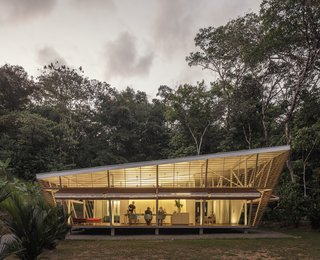 Located in Ojochal, Costa Rica, at the edge of a large tropical rain forest, the multi-disciplinary firm of A-01 (A Company / A Foundation) designed a prefabricated home that would respond to its local environment by exclusively using passive climate control.