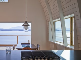 A dining set provided by the original homeowners fits in perfectly with the clean, simple design of the renovated home.