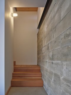 In key areas, board-formed concrete walls contrast with the texture and color of the rest of the home.