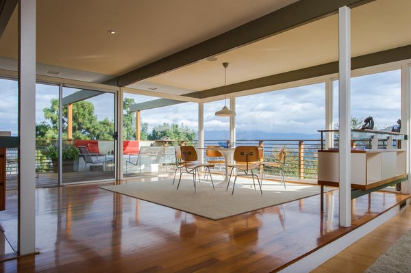 Located just above Mulholland Drive, this updated home still maintains its glamorous midcentury vibe. Built in 1961 by celebrated Los Angeles firm Buff & Hensman, the post-and-beam abode features wraparound floor-to-ceiling glass windows and sliding doors that bring the spectacular surroundings into the minimalist interior.