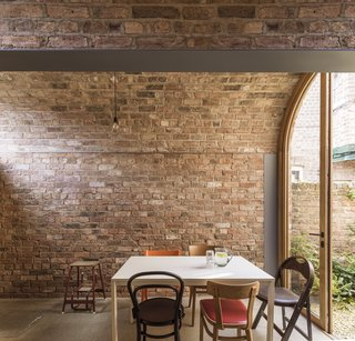 The brick walls of the extension provide a warm, textured interior that requires little more than simple furnishings and light fittings to feel comfortable and lived in.