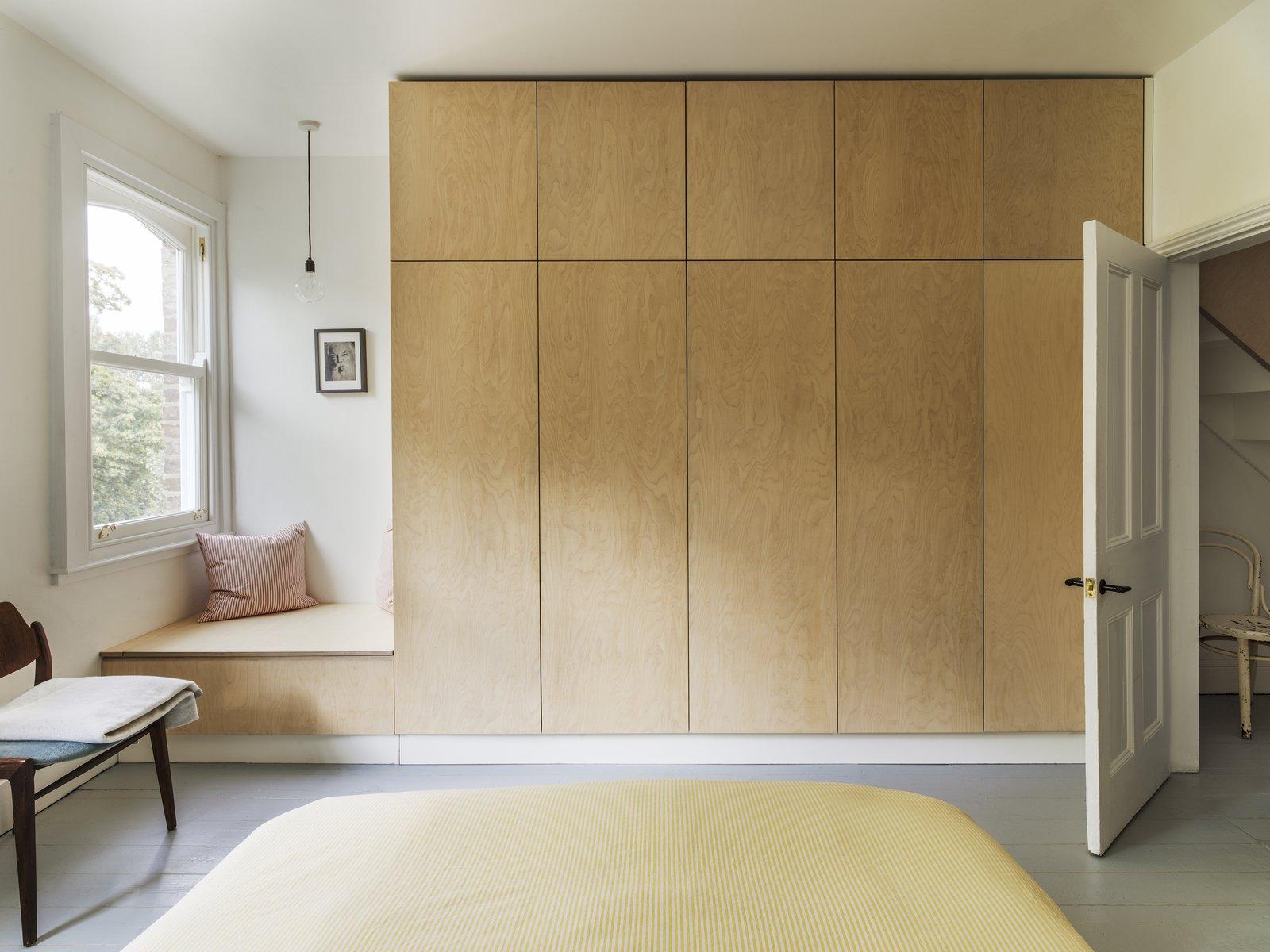 Vault House by Studio Ben Allen bedroom with minimalist wood cabinets