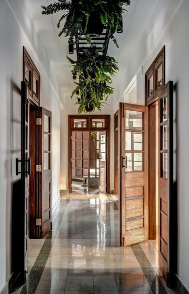 The apartment's long corridors and high ceilings allow the space to still feel airy despite its narrowness.
