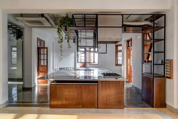 The studio space looks out into the kitchen, emphasizing the idea of transparency across multifunctional spaces.