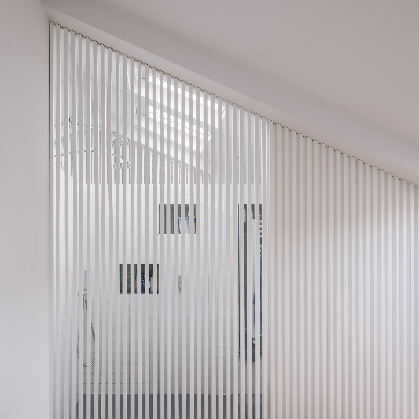 6House by Zooco Estudio white wood slat screen